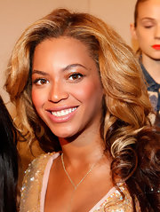 Beyonce Knowles was all about metallics at the J.Crew Spring 2012 fashion show. To recreate her look, try sweeping a shimmering copper shadow across upper lids, blending up into creases and finishing with a coat of mascara.