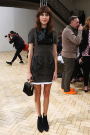 Alexa Chung's multitextured mini dress at the J.W. Anderson fashion show gave her a youthful feel.