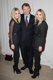Ashley looked chic, as usual, in a sheer-sleeved dress, tights and a pair of black ankle-strapped pumps.