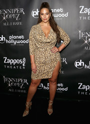 Ashley Graham flashed some leg in a high-slit snake-print dress from her PrettyLittleThing collection at the 'Jennifer Lopez: All I Have' finale after-party.