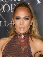 Jennifer Lopez went for bold styling with a pair of big gold hoops.