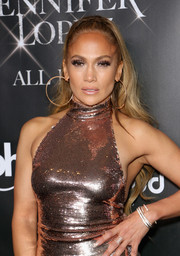 Jennifer Lopez teamed some silver bangles with a sequined outfit for the 'Jennifer Lopez: All I Have' finale after-party.