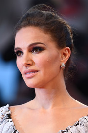 Natalie Portman finished off her looks with chunky diamond hoops by Bulgari.