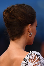 Natalie Portman swept her hair back into a classic and elegant French twist for the Venice Film Festival premiere of 'Jackie.'