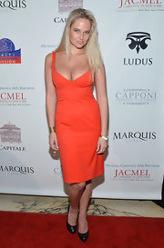 Genevieve Morton was a vibrant sight at the Jacmel Carnaval benefit in her orange cocktail dress.