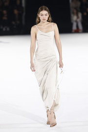 Gigi Hadid looked summer-ready in an ecru sundress while walking the Jacquemus Menswear Fall 2020 show.