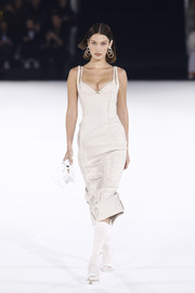 A pair of white cross-strap sandals finished off Bella Hadid's runway look.