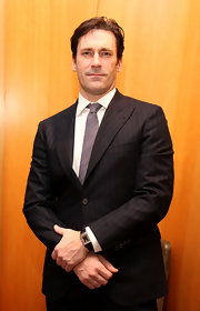 Jon looks dapper in a navy pinstripe suit at a luncheon in New York City.
