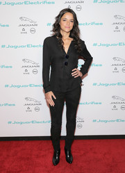 Michelle Rodriguez teamed her top with black suede pants.