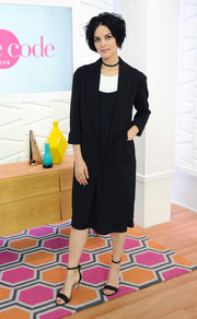 Jaimie Alexander visited Amazon's 'Style Code Live' wearing simple black ankle-strap sandals and a duster coat.
