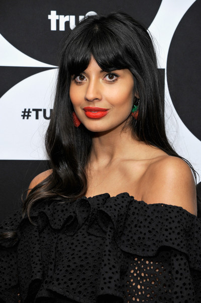 Jameela Jamil Long Wavy Cut with Bangs [hair,hairstyle,black hair,lip,bangs,beauty,long hair,eyelash,dress,brown hair,jameela jamil,the misery index,room,pasadena,california,the langham huntington hotel,spa,tca turner winter press tour 2019 - green room]