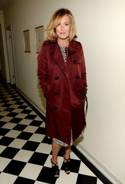 Cat Deeley arrived for the BAFTA Los Angeles Britannia Awards celebration wearing a classic burgundy trenchcoat.