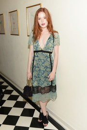 Ellie Bamber paired her dress with fringed black suede sandals.
