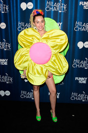 Miley Cyrus complemented her dress with a pair of neon-green platform mules by Melissa x Jeremy Scott.
