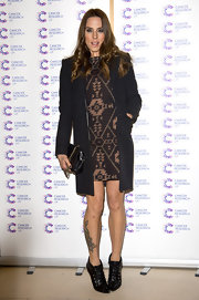 Mel C sported this cool Southwestern-inspired print dress for a slightly hippie-like look.