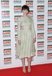 Alexandra Roach chose this pale green, plaid dress for her sophisticated red carpet look.