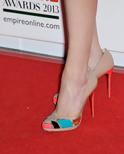 Joanne Froggart a dash of color to her pale pink ensemble with these multi-colored pumps.