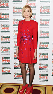 Agyness Deyn looked fab in this red cocktail dress with purple appliqued birds at the Jameson Empire Awards.