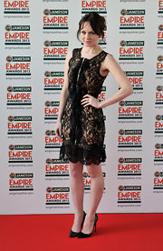 Laura completed her black lace look with a pair pointy black Louboutin 'Pigalles'.