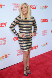 Jane Krakowski coordinated her dress with a pair of studded navy and gold sandals.