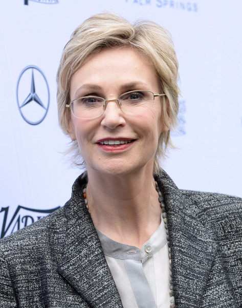 Jane Lynch Layered Razor Cut [hair,face,eyewear,hairstyle,eyebrow,blond,skin,glasses,chin,lip,directors,jane lynch,creative impact awards,parker palm springs,california,variety,mercedes-benz,brunch,palm springs international film festival]