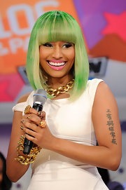 Rapper Niki Minaj showed off her newly dyed green mid-length bob. Wonder if she lost a St. Patrick's Day bet?