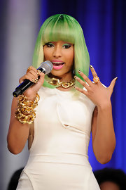 Nicki Minaj highlighted her gold jewelry with minx gold nails.