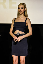 Nicola Peltz was sexy-edgy in a midnight-blue Alexander Wang crop-top with crisscross detailing during the 'Transformers: Age of Extinction' premiere in Tokyo.
