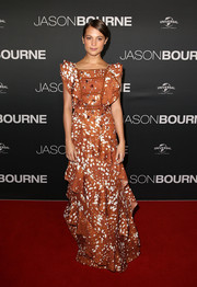 Alicia Vikander went ultra girly in a tiered, ruffled print gown by Rodarte for the 'Jason Bourne' Australian premiere.