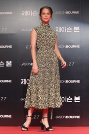 Alicia Vikander kept it modest and girly in a high-neck print dress by Celine at the 'Jason Bourne' press conference in Seoul.