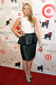 Blake Lively paired her black and white peplum frock with embellished pumps.
