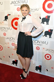 Chloe Moretz topped off her black and white ensemble with matching heels complete with bow-tie detailing.