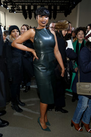 Jennifer Hudson made a chic appearance at the Jason Wu fashion show in a sleeveless green leather dress.