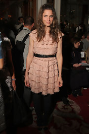 Amanda's ruffle pleated dress is a bit shapeless but her black leather belt gives the soft pink dress a nice femiine shape.
