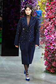 Bella Hadid was winter-glam in an embellished navy coat while walking the Jason Wu runway.