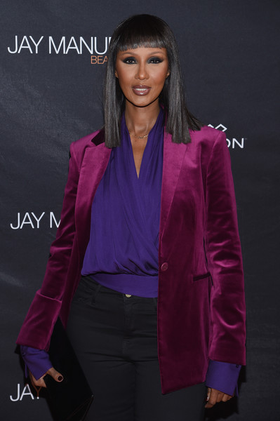 Iman paired a purple wrap top with a burgundy velvet blazer for the Jay Manuel Beauty x Simon launch.