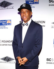 Russell Simmons wore a striped bow tie with his suit for the charity event.