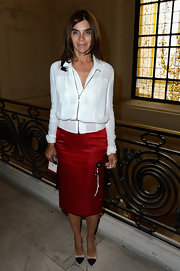 Carine showed off her slender frame with this ruby red satin pencil skirt that featured a floral detail on the side.