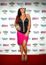 JWoww chose this black cutout monokini to show off her curves!