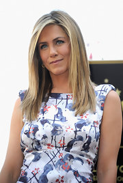 Jennifer Aniston wore her hair in a straight slightly layered cut while being honored with a star on the Hollywood Walk of Fame.