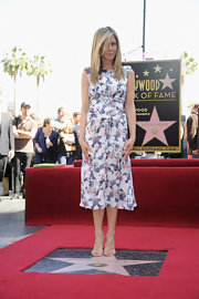 Jennifer Aniston wore this print day dress to be honored on the Hollywood Walk of Fame.