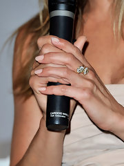 Jennifer shined in a 1920's cushion-cut diamond crossover ring.