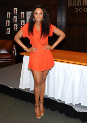 Jennifer Hudson accessorized her orange mini dress with cognac platform sandals.