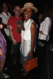 June Ambrose was casual yet stylish in an oversized sleeveless button-down during Jennifer Hudson's New York & Company Soho campaign launch.
