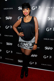 Jennifer Hudson styled her top with a monochrome mixed-print mini skirt.