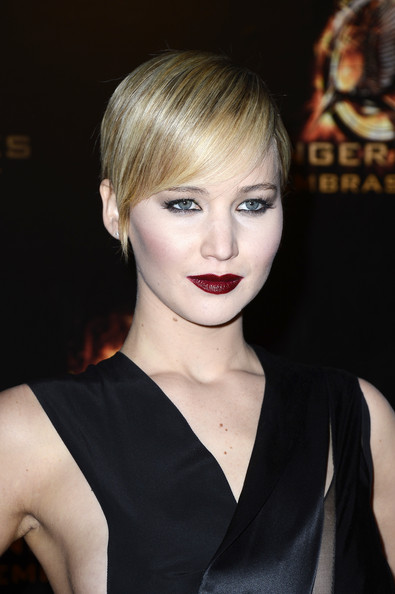 Jennifer Lawrence Pixie [the hunger games: catching fire,hair,fashion model,human hair color,hairstyle,eyebrow,beauty,blond,chin,bangs,fashion,lipstick,bobbi brown,jennifer lawrence,hair,shades,brown,fashion model,le grand rex,paris premiere,bobbi brown,lipstick,color,red,cosmetics,wine,tints and shades,lip,brown,shades of brown]