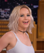 Jennifer Lawrence accentuated her eyes with lots of gray shadow.