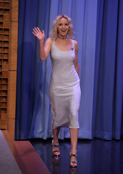 Jennifer Lawrence went for edgy-glam styling with spiked silver sandals by Christian Louboutin.