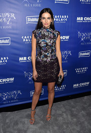 Camilla Belle injected more shine with a pair of silver Tamara Mellon Frontline sandals.