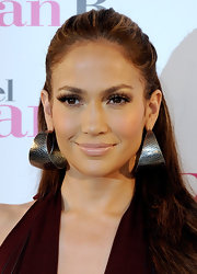 "J-Lo showed off some killer hoops while walking the red carpet at ""The Back Up Plan"" photo call in Madrid. Her hoops were a great addition to her half-up half-down hairdo."
